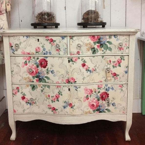 a dresser renovated with floral wallpaper is an easy DIY project