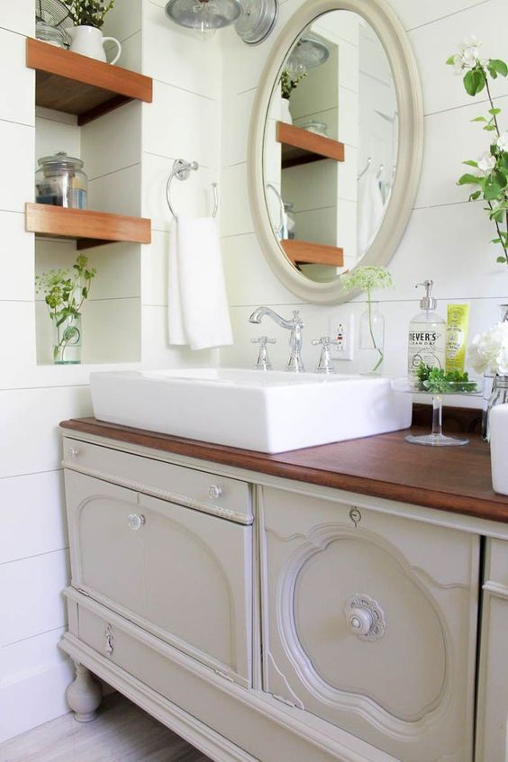 a vintage buffet transformed into a bathroom vanity