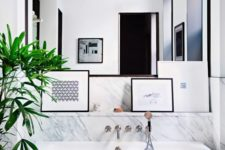 22 chic modern marble bathroom with a free-standing bathtub and a framed mirror