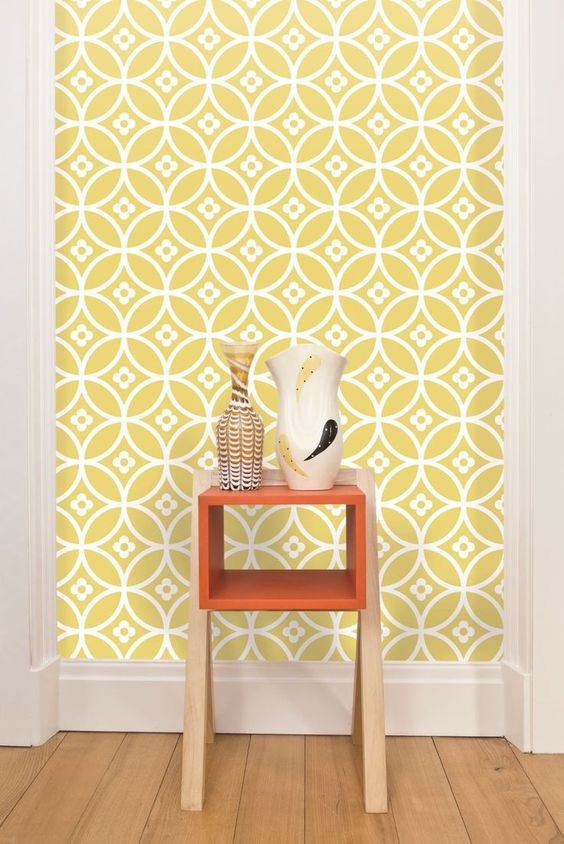 geometric yellow and white wallpaper with tine flowers in an entryway