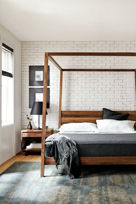 Wooden Frame Bed Makes This Industrial Inspired Bedroom Cozier