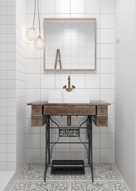 Singer sewing machine stand as bathroom sink basin is a unique and eye-catchy idea