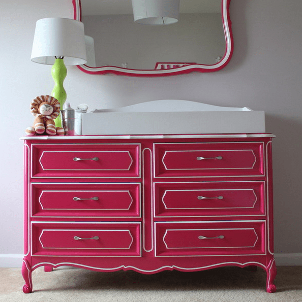 a dresser renovated with bold pink paint and new handles