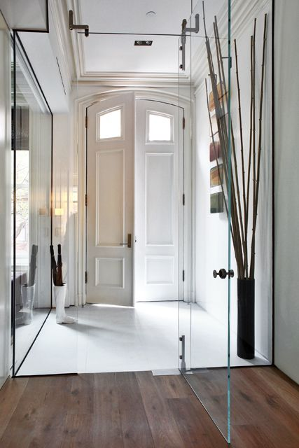 frameless glass doors are the best way to separate the spaces gently