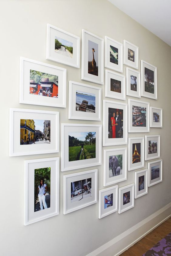 perfectly arranged gallery wall with pics of different sizes