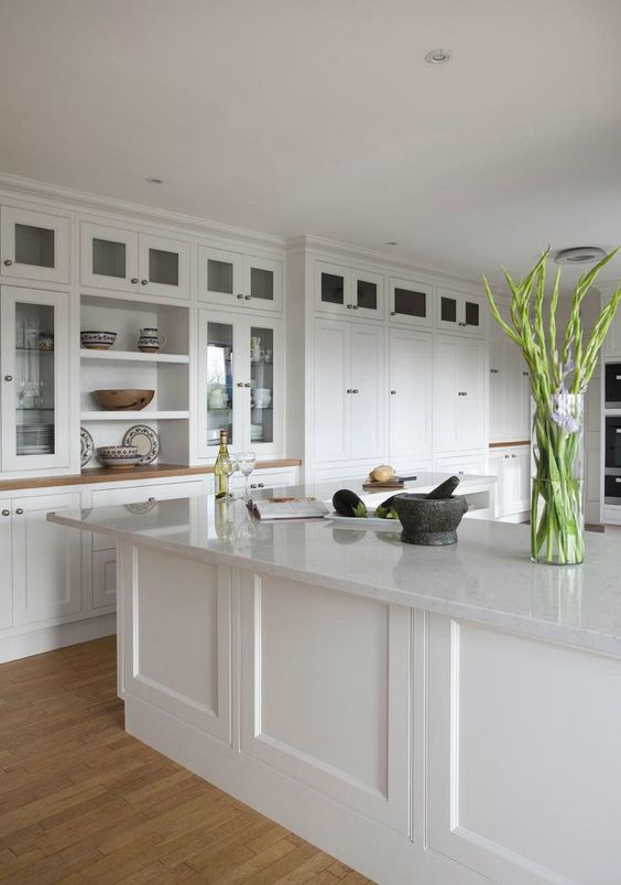 white quartz countertops, cabinets and some green plants for a eco-friendly home