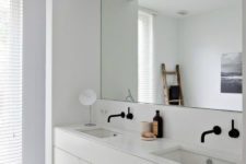 24 ultra-minimalist white bathroom with a mirror niche to accentuate the sink area