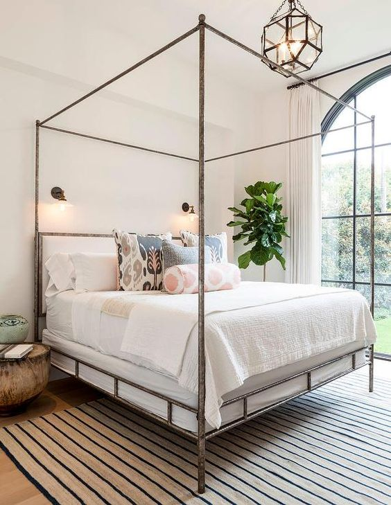 vintage-loooking bed with a frame of rusty metal for a bold statement