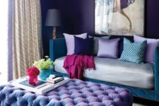 24 violet and teal glam living room with a unique chandelier and a crazy artwork