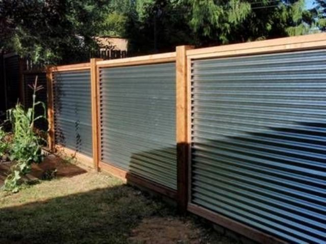 warm-colored wood and corrugated metal for a privacy fence