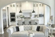 25 all-white kitchen with greys and a grey and silver living room with an open plan