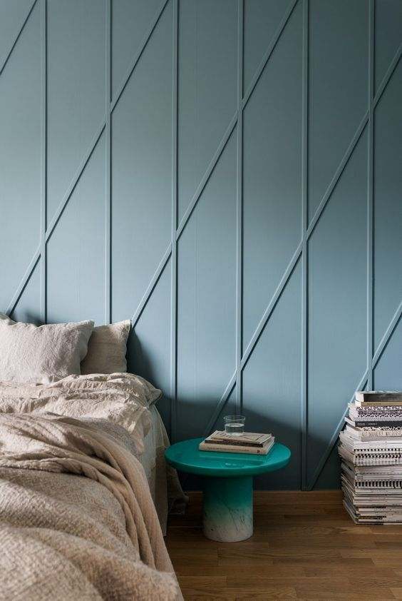 cool dusty blue wall panels with an abstract print