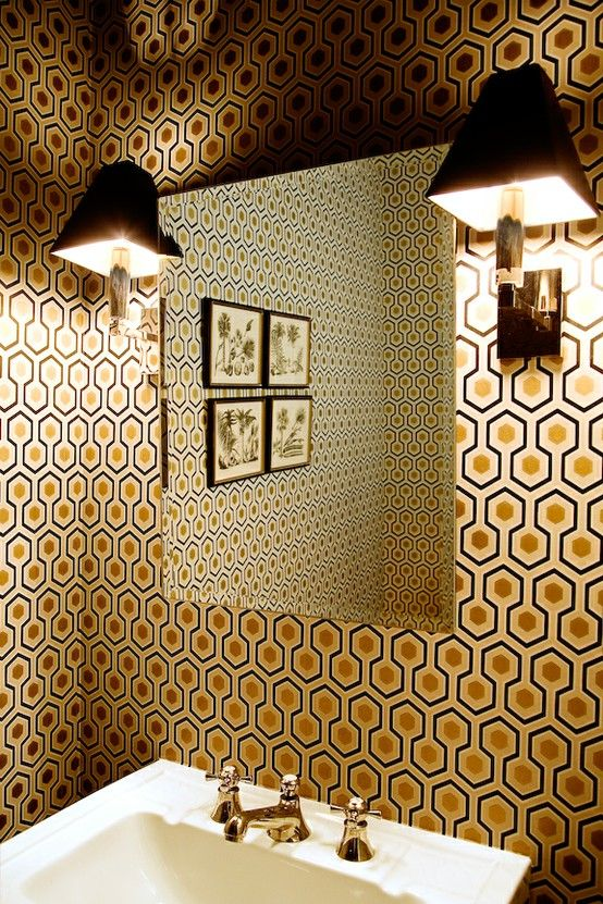 hexagon print with gold inside and retro faucets for a bathroom