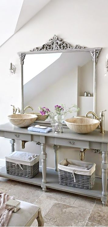 light grey bathroom vanity with open shelving and baskets