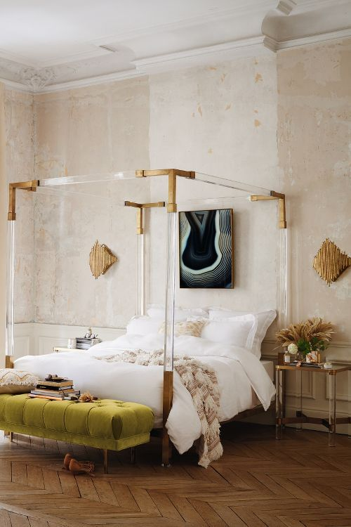 lucite canopy bed frame with metallic touches looks jaw-dropping