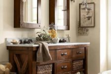 25 rustic industrial dark stained wood vanity with baskets and a contrasting top