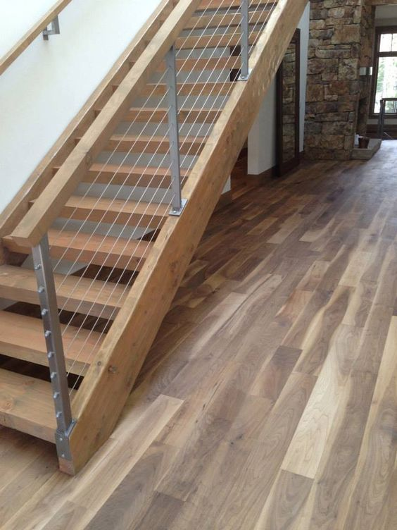 Warmcolored Wood Staircase And Wood And Cable Railing To Give It A Fresher  Modern Look