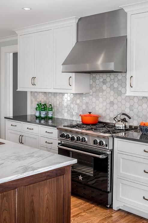 white shaker cabinets with quartz countertops. white cabinets accented with oil rubbed bronze pulls and a charcoal gray quartz countertop shaker countertops y