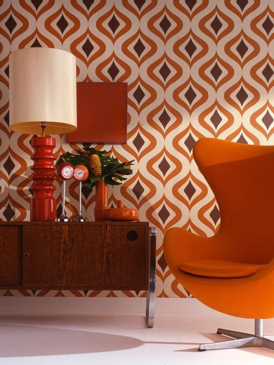 orange and brown geo mid-century modern wallapaper and corresponding furniture