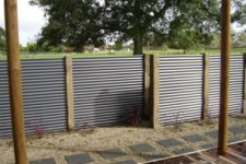 27 corrugated metal sheet fence with wooden posts