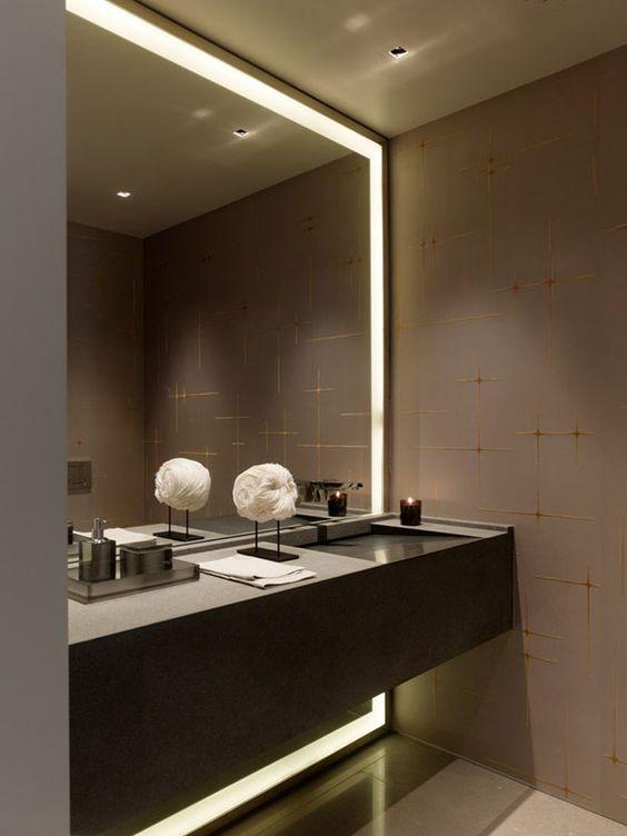 Dark Glam Bathroom With A Lit Up Mirror In Niche