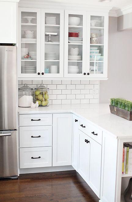 farmhouse white kitchen with white subway tiles and counters