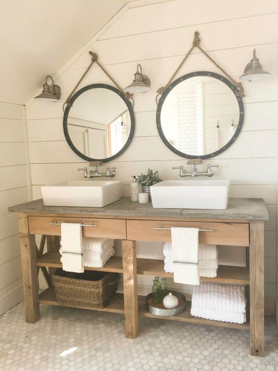 rustic bathroom vanity with open shelves and a reclaimed countertop