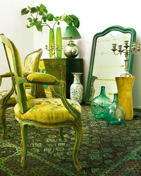 sage green carper and accessories, yellow upholstery and emerald touches
