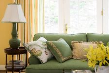 28 green upholstery and striped curtains with touches of orange, green and yellow