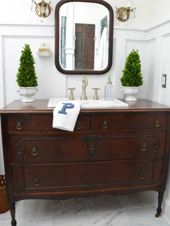rustic vintage sideboard with antique handles repurposed into a vanity