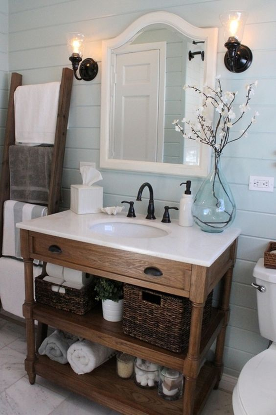 rustic wood bathroom vanity with open shelving and a drawer, a white counter
