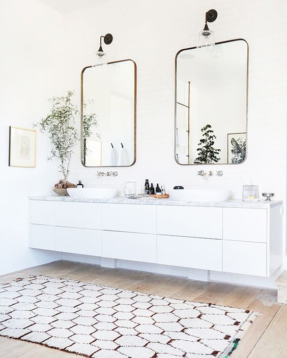 modern white floating vanity with a marble top