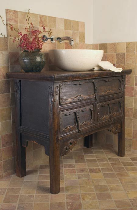 rustic vintage vanity of dark stained wood on tall legs - 29 Vintage And Shabby Chic Vanities For Your Bathroom - DigsDigs