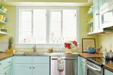 29 sunny yellow walls and mint painted cabinets make this kitchen warm and inviting