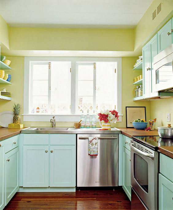 sunny yellow walls and mint painted cabinets make this kitchen warm and inviting