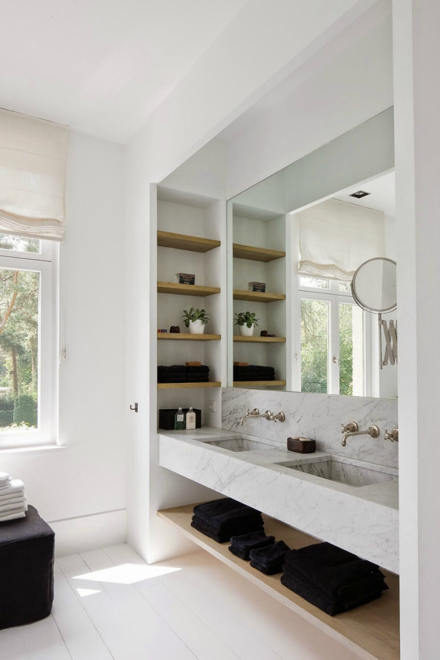 minimalist bathroom with a niche with storage shelves and a mirror