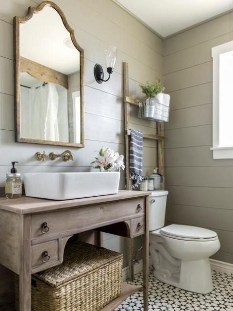 vintage whitewashed bathroom vanity with an open shelf and some drawers can be DIYed