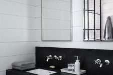 31 black and white industrial bathroom features a honed black marble floating dual vanity accented with built in polished nickel towel bars and square undermount sinks