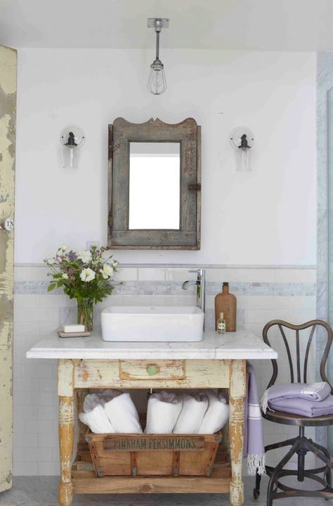 shabby reclaimed wood vanity with a drawer and an open shelf and a modern counter