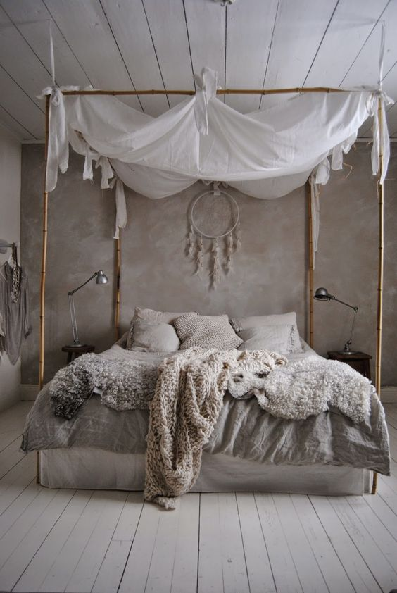 Scandinavian-inspired bedroom design with a bamboo frame bed and a canopy for peaceful sleep