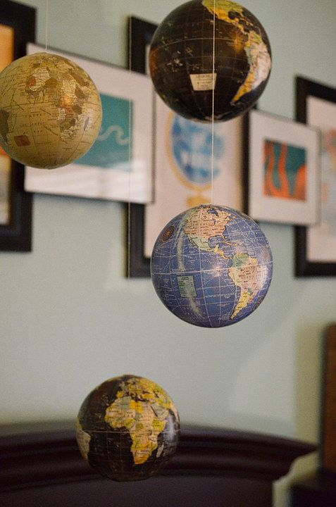 hang globes in your nursery as a kid's mobile - it's a very inspiring idea