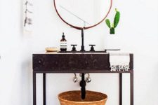 33 stone vanity on metal legs with a glass shelf underneath