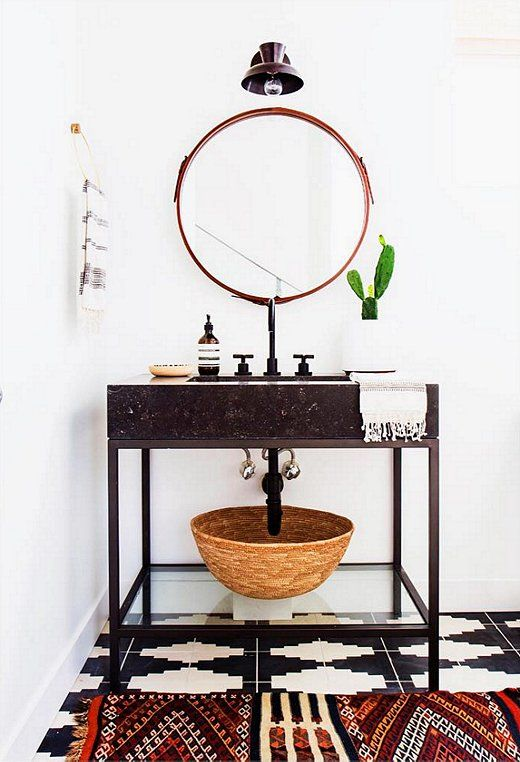 Stone Vanity On Metal Legs With A Glass Shelf Underneath