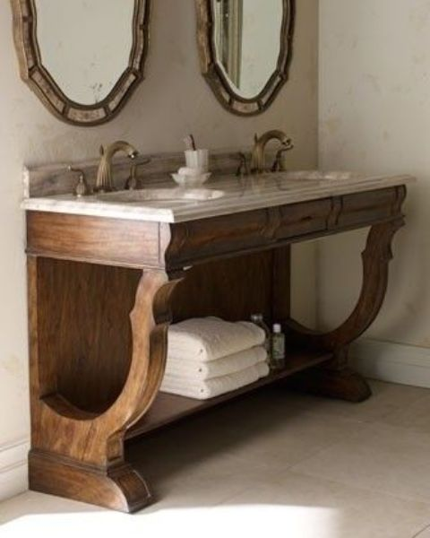 Vintage Rustic Bathroom Vanity With A Stone Countertop With An Open Shelf