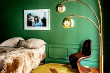 34 emerald walls and the ceiling and a yellow floor create a bold statement