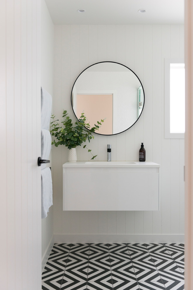 A minimalist glossy white vanity with white countertop is perfect for modern bathrooms. (Style My Abode NZ)