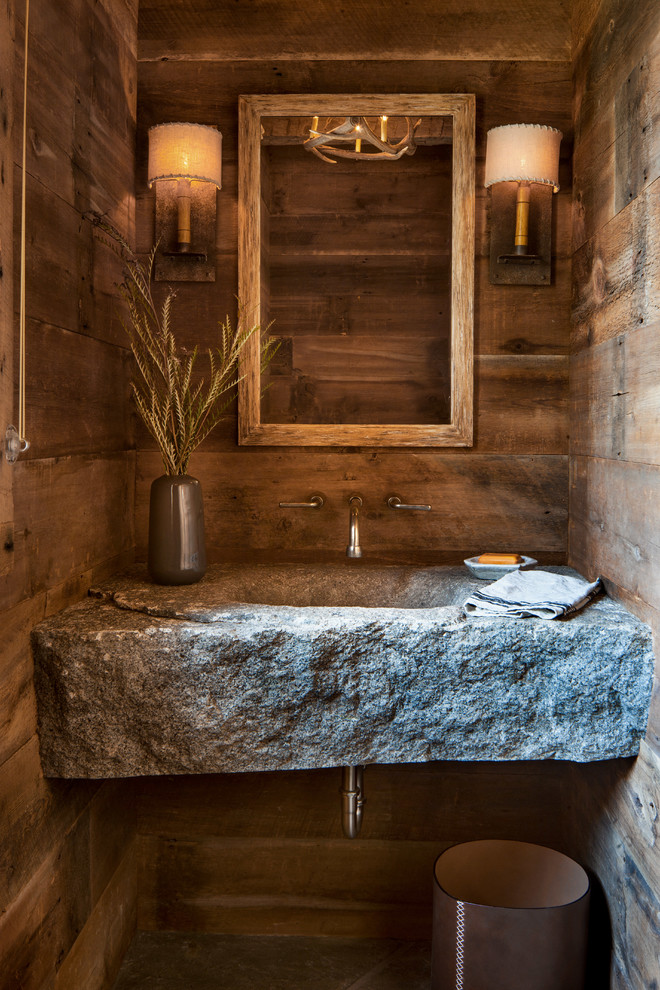 A stone slab vanity with an integreated sink definitely looks raw and industrial. (North Fork Builders of Montana, Inc.)