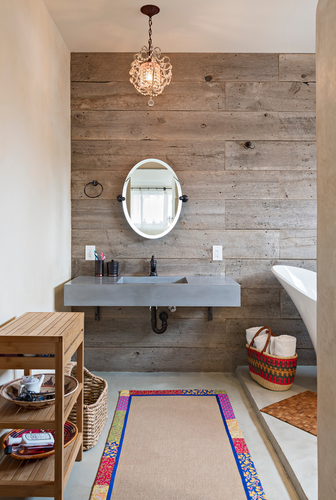 A floating concrete vanity looks great on a rustic wood accent wall. (Dane Cronin Photography)