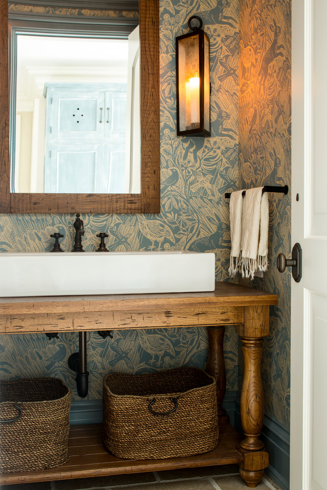 A repurposed vintage console table works well as a vanity. (ML Interior Designs)