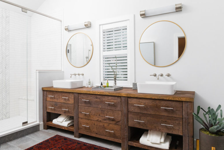 This double reclaimed wood vanity features lots of spacious drawers and looks amazing by a pure white wall. (Cummings Architects)